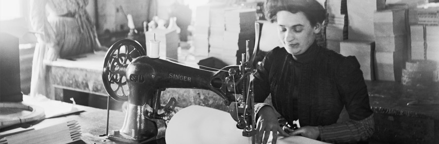 Middle-aged woman sewing on a belt driven Singer machine at the Richmond & Backus Company, Detroit, Michigan, ca. 1905.