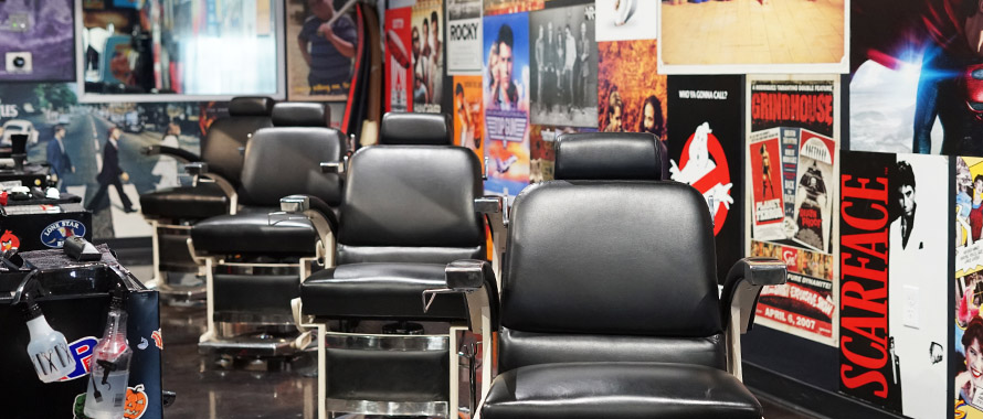 The interior of Diesel with a row of barbershop chairs and movie posters on every inch of the walls.