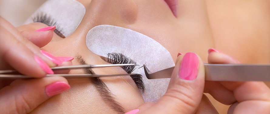 Close up of a women getting eyelash extensions.