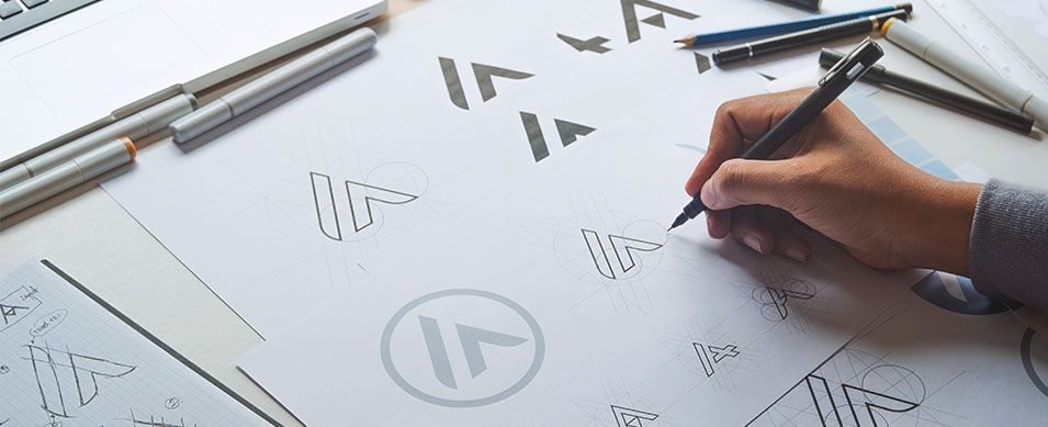 A designer creating a new logo for a company rebranding,